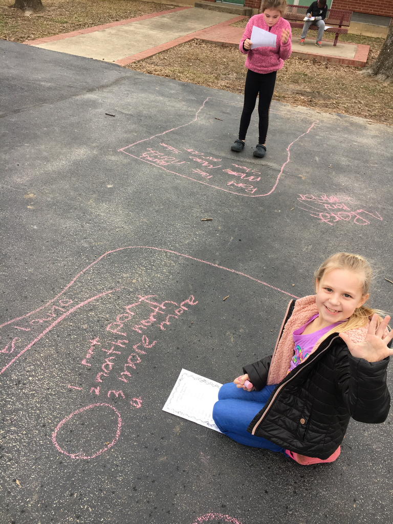 2nd grade took advantage of the nice weather on Monday and practice their spelling words with chalk!